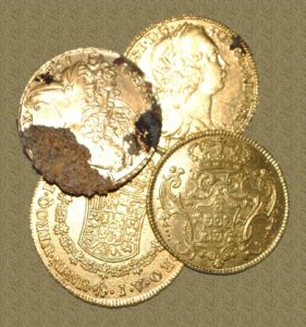 "Here are four more of the beautiful gold coins we were finding last year. I was doing this as a consultant, so I'm not at liberty to reveal the exact location or which vessel we believe this to be. Its a neat site, and I'm sure there are lots more coins there, but I'm far more excited about my shipwrecks off Cape Romain. I expect to find even more valuable treasures on them, which is exactly why my current efforts are here in South Carolina. These coins all date from the 1700s and are shown uncleaned and ""as found."" Note the rust stain and sand encrustation that is on one of them. The three smaller coins are Portuguese while the large one is a Spanish eight escudo. (Note: The background has been photo shopped to avoid distraction.)"