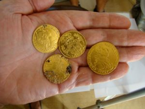 Gold coins found in less than 20 feet of water.