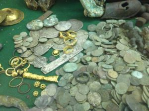 This is a closeup of some of the many coins and other treasures Dr. E. Lee Spence and his people have found over the years.